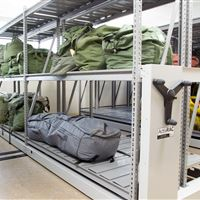 Parachute accessory storage on wide span shelving