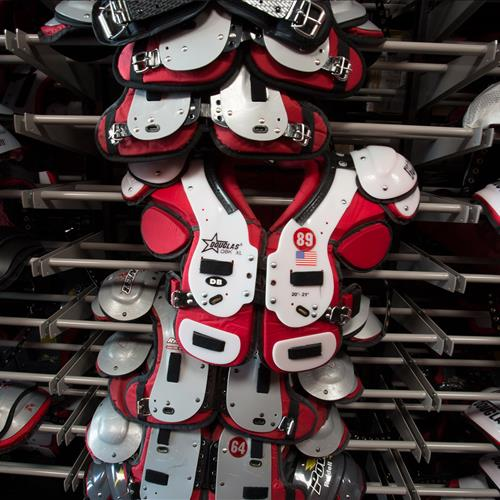 Overhanging football shoulder pad storage at Stanford University