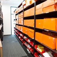 Athletic shoes and uniforms stored on mobile shelving at Stanford University