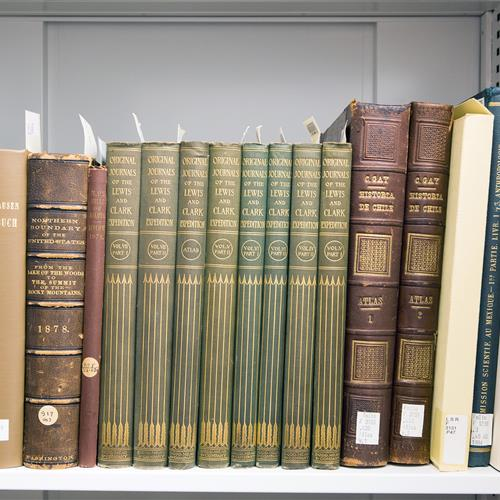 Selection of books being archived in museum cabinet at California Academy of Sciences Building