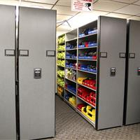 Taser cartridges in bin storage on powered compact shelving at Aurora Police Department
