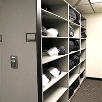 Riot gear on powered high-density shelving at Aurora Police Department