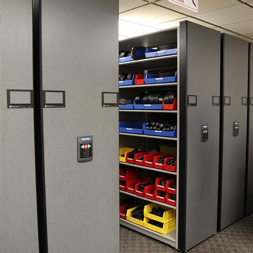 Police equipment in bin storage on powered compact shelving