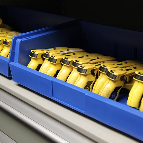 Taser equipment in bin storage on powered compact shelving