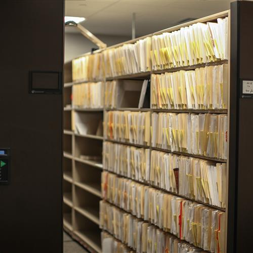 Record storage on PIN pad access mobile shelving