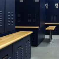 Personal storage lockers with benches and drawers in Bensalem Police Department Locker Room