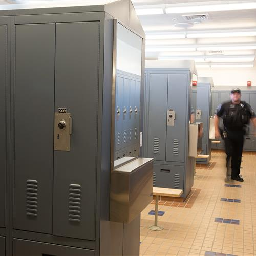 Personal storage lockers using double door and single door access in locker room at Central Marin Police Department