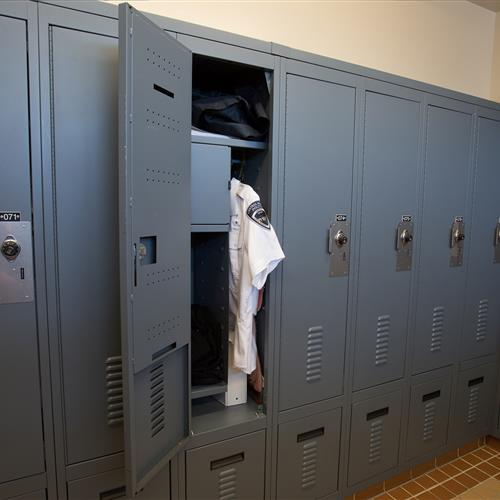 Police uniform inside law enforcement locker system