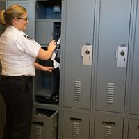 Police uniform and personal storage in law enforcement locker at Central Marin Police Department