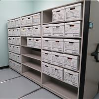 Office supplies on manual mobile modular shelving