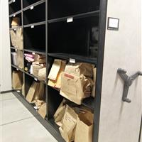 Long-term evidence storage on mechanical-assist mobile shelving