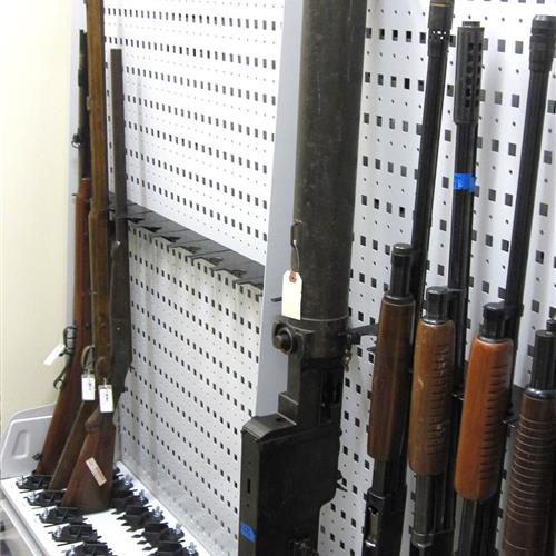 Wall-mounted shotgun storage rack