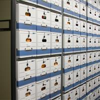 Evidence storage in banker boxes on compact mobile shelving