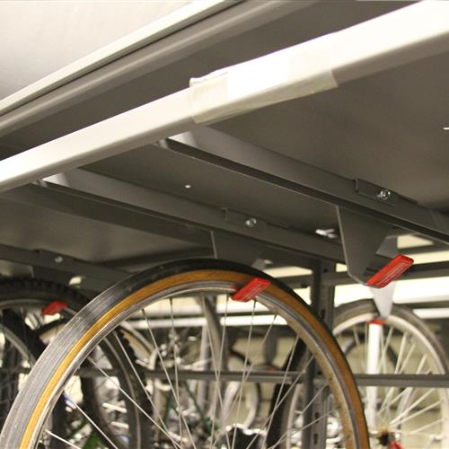 Up-close view of bike hanging on hanging storage rack in static shelving