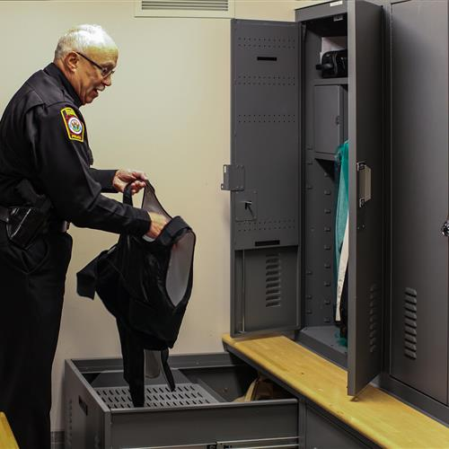 Law enforcement lockers and drawers containing police uniforms