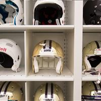 Helmet equipment stored on 4-post bin shelving system