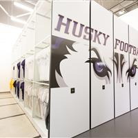 Athletic equipment storage of Jerseys and apparel on compact mobile shelving