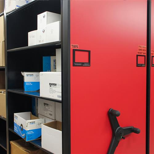 athletic equipment supplies on mechanical assist mobile high-density shelving