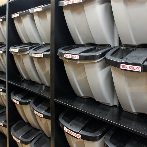 Tote storage for athletic equipment on static shelving