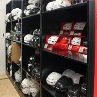 Helmet Hockey athletic equipment stored on 4-post shelving
