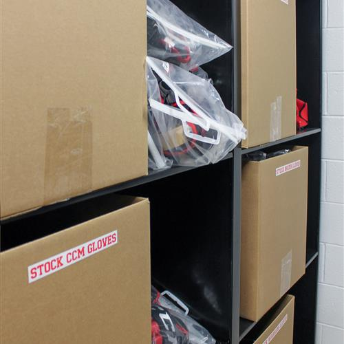 Bulk athletic equipment stored on static shelving