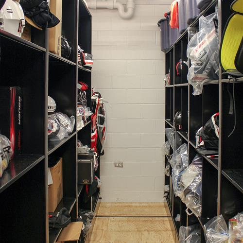Athletic equipment helmet storage on compact mobile shelving