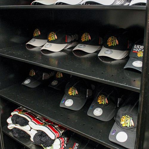 Athletic apparel stored on static shelving
