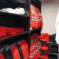 Athletic equipment stored in static high-density shelving