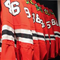 Jerseys on hanging racks in static storage shelving unit