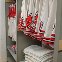 Athletic equipment hung on static shelving