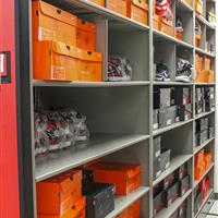 Shoe athletic equipment storage on 4-post compact mobile shelving