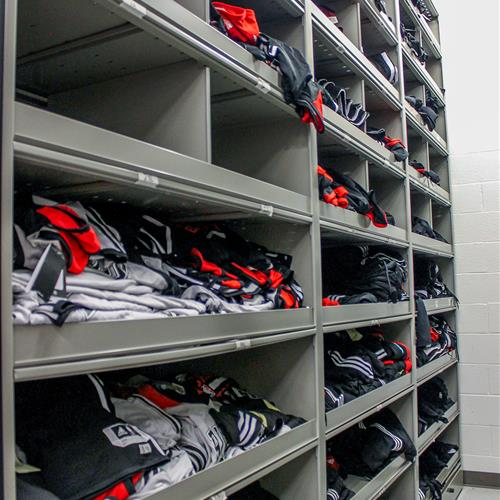 Athletic apparel stored on 4-post bin shelving