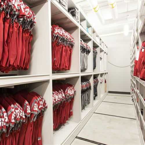 Athletic equipment on mobile high-density shelving