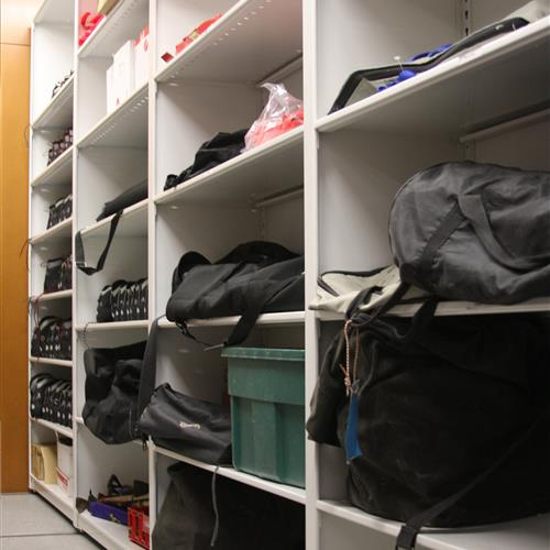 Equipment storage on 4-post shelving