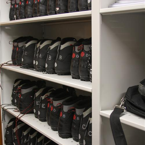 Climbing boots on static shelving system