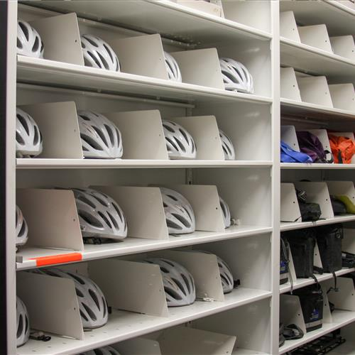 Helmets and nap packs on 4-post shelving