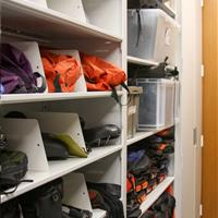 Adventure gear on 4-post shelving separated by dividers