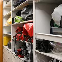 Adventure gear on high-density shelving shown with modular drawers
