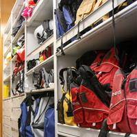 Hiking gear and supplies on 4-post shelving