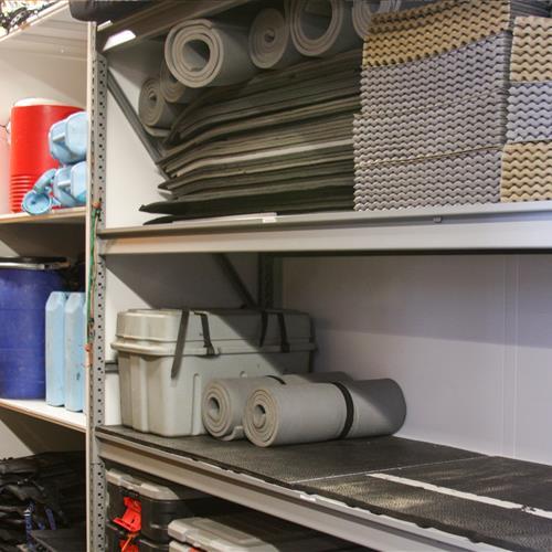 Various adventure equipment on wide span shelving