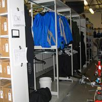 Jackets hanging on static shelving system