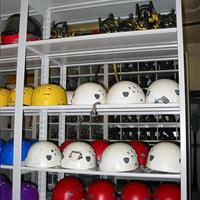 Helmets on pass-through static shelving