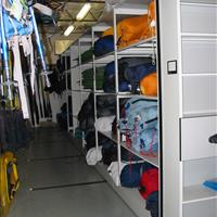 Recreation equipment on mechanical assist mobile shelving