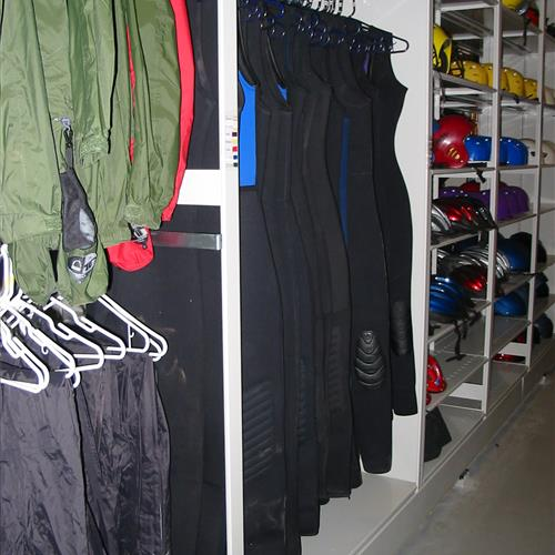 Recreation equipment on hanging racks and shelving