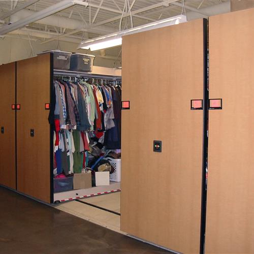Theater costumes and storage on powered compact mobile shelving