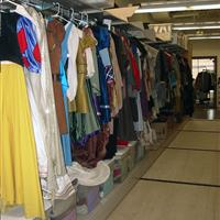 Costume wardrobe storage on shelving with clothing rods