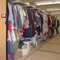 Costume clothing on hanging rack in compact mobile shelving system