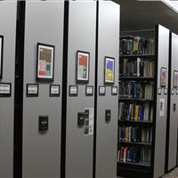 One button access to the library shelving with compact mobile shelving