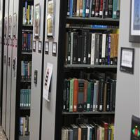With compact mobile storage system multiple aisles are able to be open to access library shelving