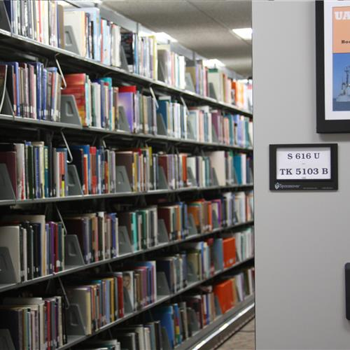 Powered mobile shelving for library book storage